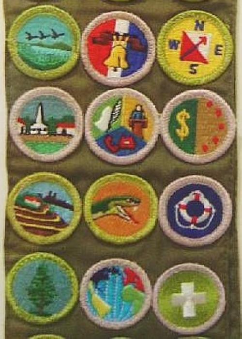 website says merit badges can be worn on the back of the merit badge ...